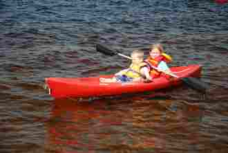 Kids having fun in a Clyffe House kayak